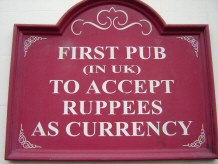 Sign outside the Glassy Junction pub saying that it was the first one in the UK to accept rupees (Jerri Daboo, 4 Feb 2011)